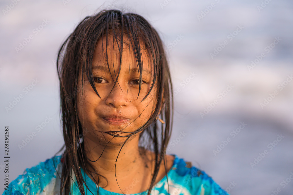 Fototapety, obrazy: beach lifestyle portrait of young beautiful and happy 7 or 8 years old Asian American mixed child girl with wet hair enjoying holidays playing in the sea having fun