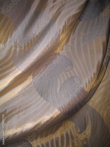 Photo sur Toile Les Textures drapery of golden fabric with a pattern