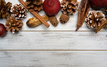 Christmas Decorations On A White Wood Background With Copy Space. Pine Cones, Garland, Berries And Potpourri