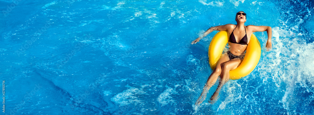 Fototapety, obrazy: Summer vacation. Laughing young woman enjoying an aqua park. Fun in the pool