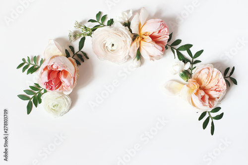 Wall Murals Floral Decorative wreath, floral garland, composition with pink English roses, ranunculus and green leaves on white table background. Flower pattern. Flat lay, top view. Wedding, birthday styled stock photo.