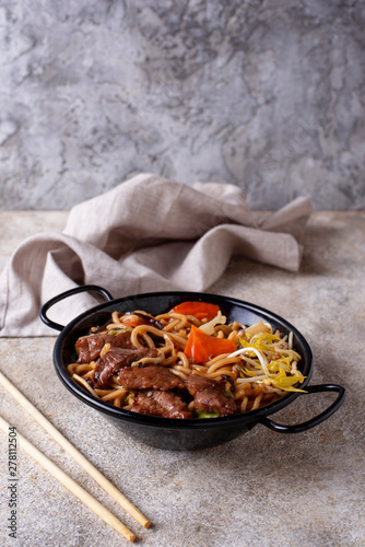 Photo  Asian noodles with meat and vegetables