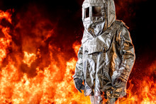 Fireman In A Special Protection Suit. Professional Protection Against Heat And Open Flame