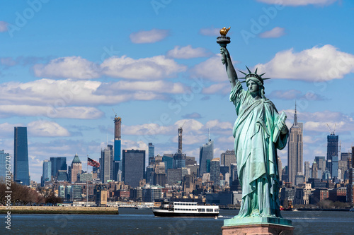 Photo sur Aluminium New York The Statue of Liberty over the Scene of New york cityscape river side which location is lower manhattan,Architecture and building with tourist concept