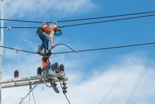Electricians Repairing,electricians Repairing Wire On Electric Power Pole, Power Linesman Climb The Pole.It's A Dangerous Job.