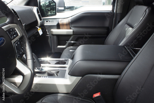 Photo  Interior shot of passenger and driver side of a new 2019 Ford F-150 LAriat at a