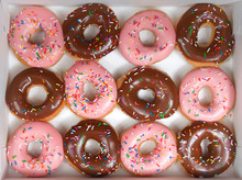 Top View Flat Lay Of One Dozen Glazed Donuts, Alternating Strawberry And Chocolate In A White Box Isolated. Are Donuts Becoming A New Fad Or The New Trend. Gourmet Style Fancy Donuts.