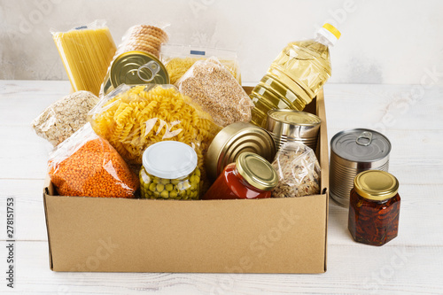 Obraz Various canned food, pasta and cereals in a cardboard box. - fototapety do salonu