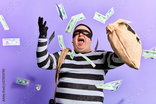 Fotomural happy cheerful thief enjoying stolen money