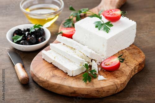 Fototapeta Sliced Feta cheese with herbs and olive oil. obraz