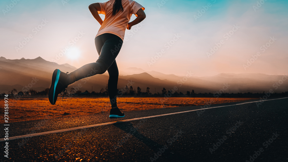 Fototapety, obrazy: Woman enjoys running outside with beautiful summer evening in the countryside.