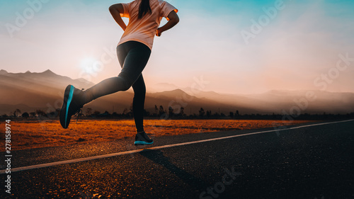 Leinwand Poster Woman enjoys running outside with beautiful summer evening in the countryside