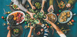 Leinwandbild Motiv Company of friends of different ages gathering for Christmas or New Year party dinner at festive table. Flat-lay of hands holding glasses with drinks, feasting and celebrating holiday, top view