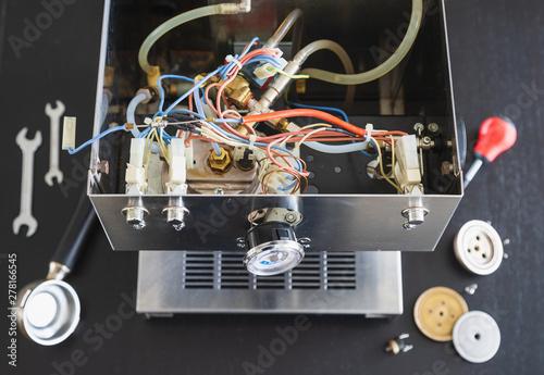 Fotografia, Obraz The interior of a defective espressomachine, ready to be repaired