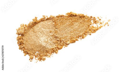 Obraz Texture of gold eye shadow isolated on white background. Macro texture of broken gold powder - fototapety do salonu