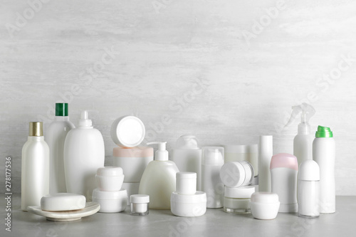 Fotografie, Tablou Different body care products on table against light background