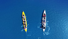 Kayaking Top View. Group Of Kayaks Rowing Together. Aerial View From Drone.