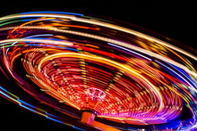 An Illuminated Carousel At The...