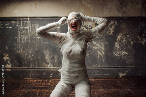 Photo mummy screams in horror and tears the bandages