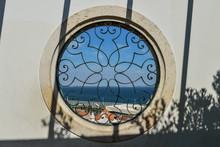 View From Miradouro Santa Luzia Through Round Window