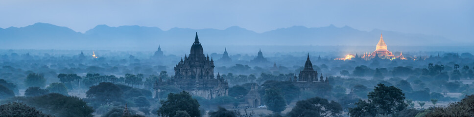 Bagan panorama at night with golden Shwezigon pagoda, Myanmar