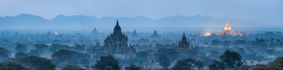 Bagan panorama at night with golden Shwezigon pagoda, Myanmar