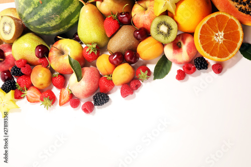 Fresh summer fruits with apple, peach, papaya, berries, pear and apricot.