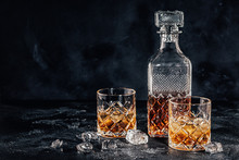 Glasses Of The Whiskey With A Square Decanter