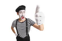 Cheerful Young Pantomime Man Showing Thumbs Up