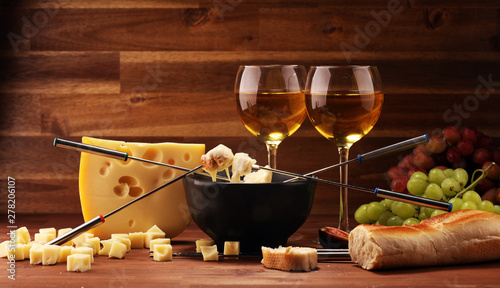 Gourmet Swiss fondue dinner on a winter evening with assorted cheeses on a board Canvas-taulu