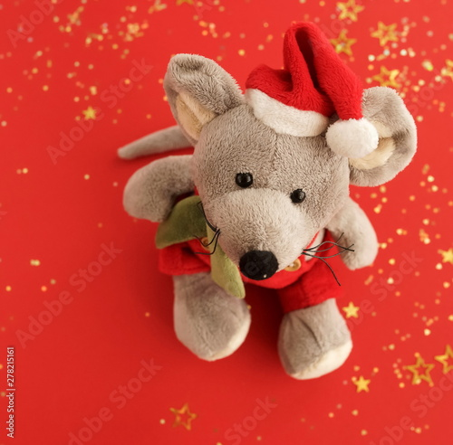 Christmas background.  Xmas rat, mouse toy, symbol chinese happy new year 2020. Close up mouse toy in santa claus red hat and new year decorations. horoscope sign 2020. Copy space
