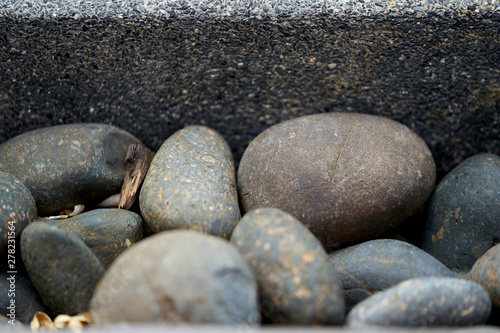 Round and oval shape Stones with concrete wall #278231564