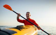 Active Senior Man Paddling Kayak
