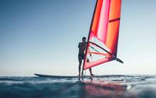 Windsurfer Catch The Wind On Windsurf Board
