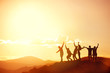 canvas print picture - Happy friends or big family's silhouettes at sunset mountains