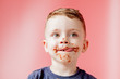 Leinwandbild Motiv Little boy eating chocolate. Cute happy boy smeared with chocolate around his mouth. Child concept.