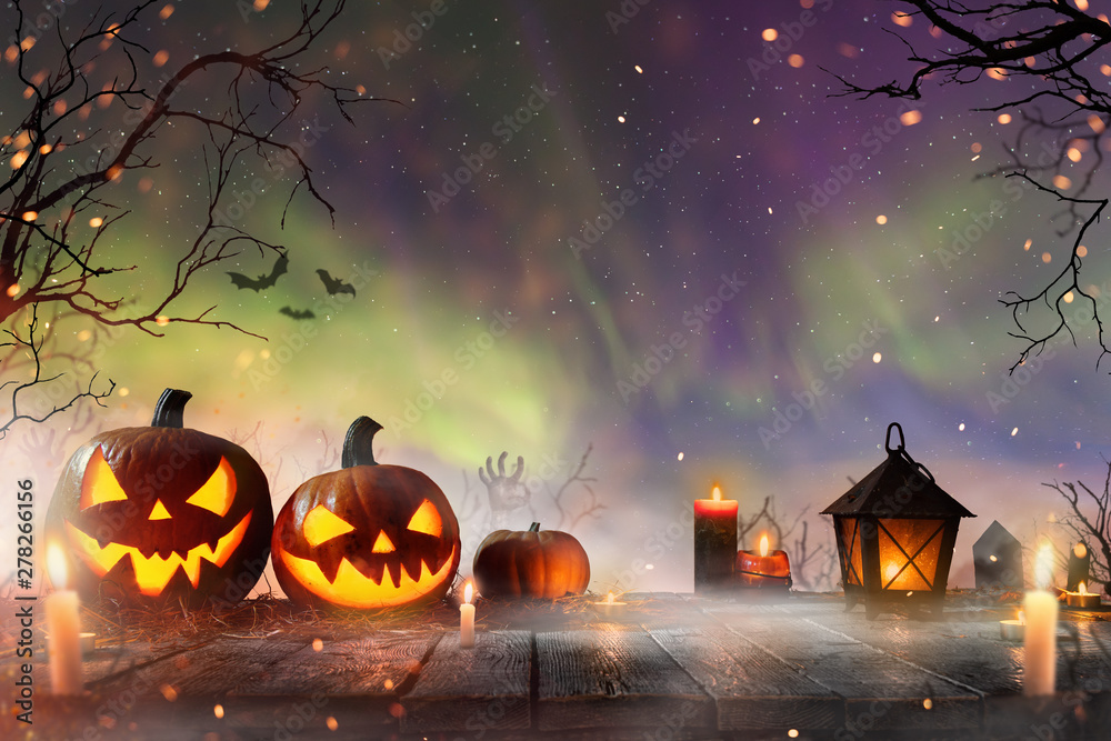 Fototapety, obrazy: Halloween pumpkins on dark spooky forest with blue fog in background.