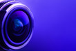canvas print picture - Camera lens with purple backlight. Side view of the lens of camera on purple background. Purple camera Lens close Up.