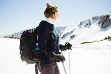 Woman With Skis On Top Of A Mountain