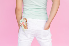 A Child Has A Messy Dripping Ice Cream Cone In Her White Pants