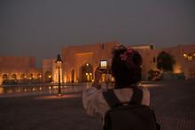Woman Taking Photos Of A Building In Katara, Doha