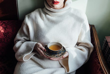 Woman Holding Vintage Tea Cup