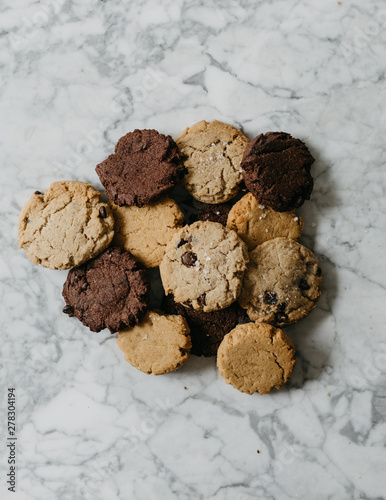 Assorted baked cookies on marble table