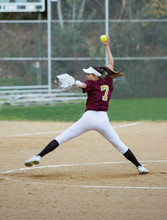 Female Softball Player Throwing A Fast Pitch