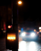 Wait Sign Lighted On On A Traffic Light