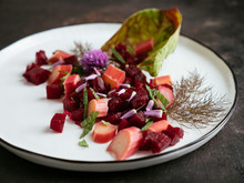 Close Up Of Beet And Rhubarb Salad Served On Plate