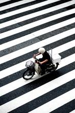 Motorcyclist On Zebra Crossing, Japan