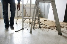 Aluminum Ladders Are On The Floor And Ceiling Debris And Large Amounts Of Dust, Blurred Photographs