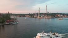 Aerial View Over Passenger Ship Towards Stockholm Amusement Promenade Attraction.
