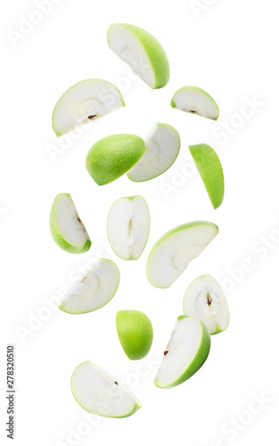 Slice ripe green apple falling isolated on white background with clipping path Canvas Print
